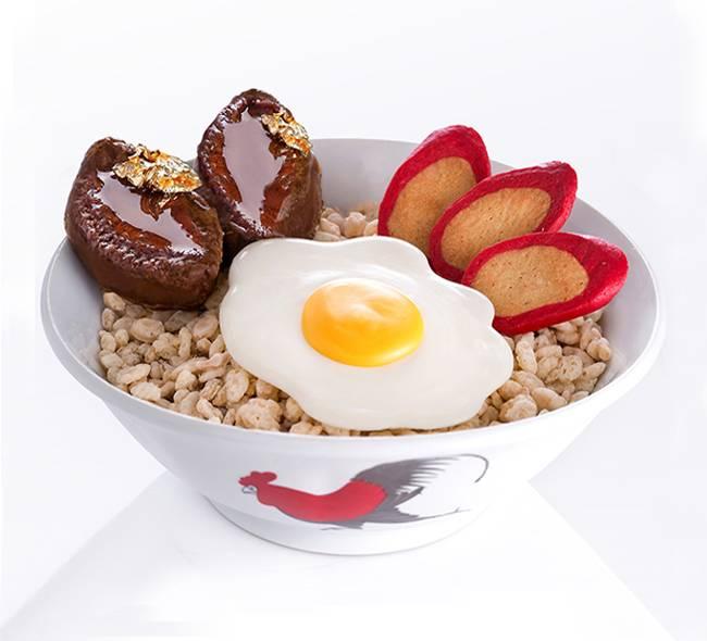 廚神「鮑魚紅腸煎蛋飯」蛋糕,以栗子忌廉、金栗、脆米、曲奇紅腸、朱古力鮑魚及海綿蛋糕製成。(特價2,每個一磅)